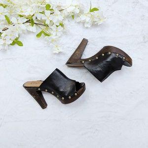 Candie's brown and black leather heels